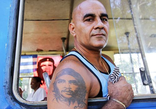 Man with a Che Guevara tattoo on the anniversary of the bombing of Cuba