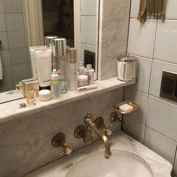 Bathroom shelf with beauty products