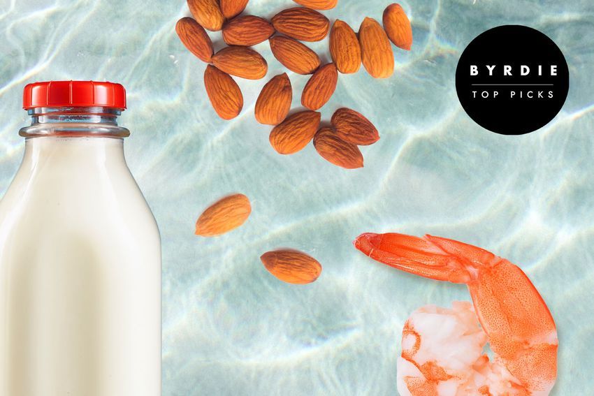 Photo composite of a glass bottle of milk, a pile. of almonds and a cooked shrimp with tail