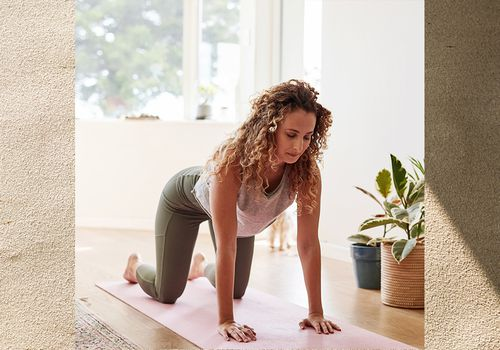 Woman on all fours getting ready to work out