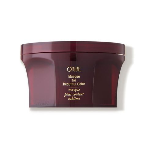 Tub of Oribe's Masque for Beautiful Color on a white background.