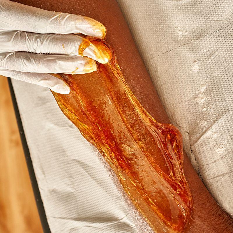 sugar wax applied to leg