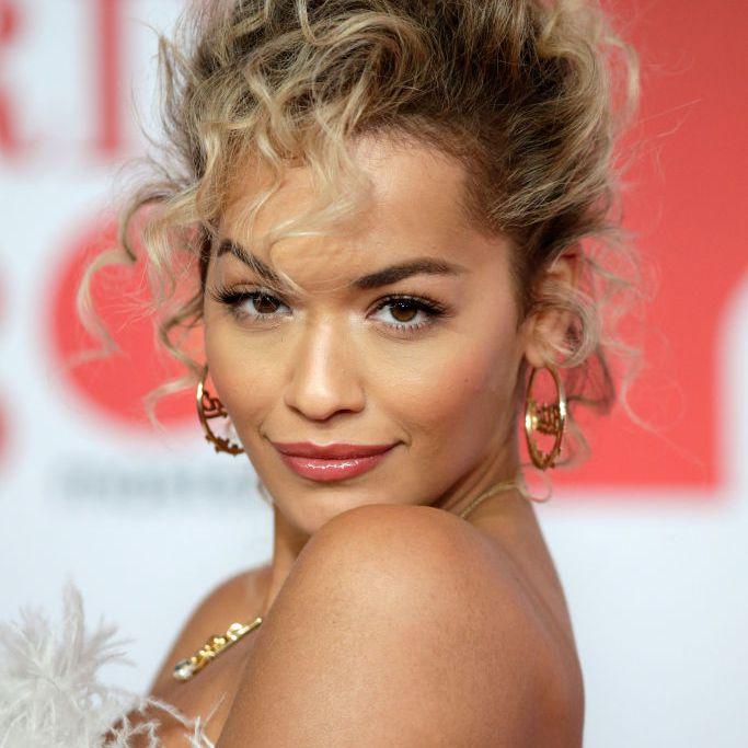 Rita Ora high messy curly bun
