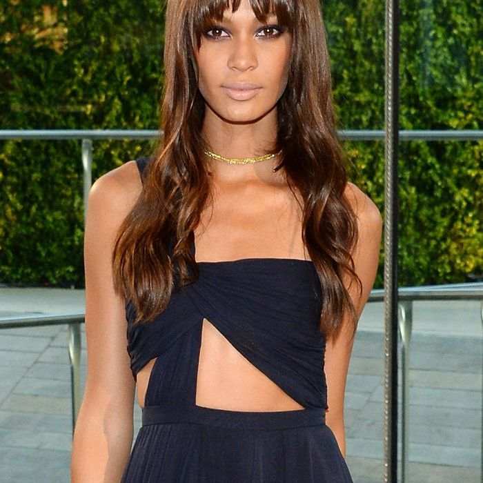 How To Find The Best Part For Your Face Shape 2014: Joan Smalls with fringe and cut out dress