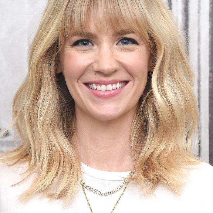 January Jones wavy blonde mid-length hair with bangs