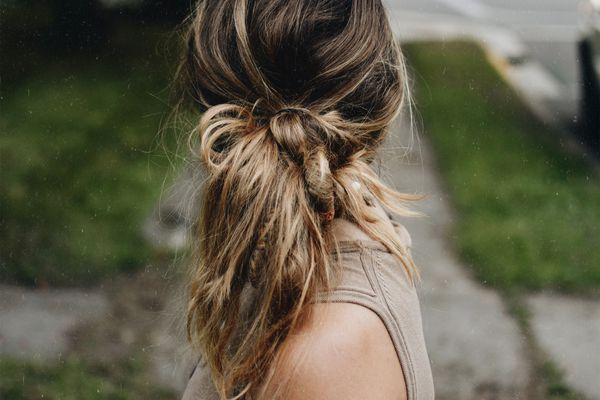 Woman with messy ponytail