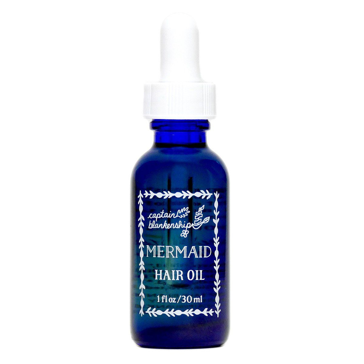 mermaid hair oil in a dropper bottle