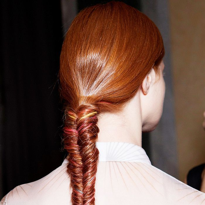 woman with red hair in a fishtail braid