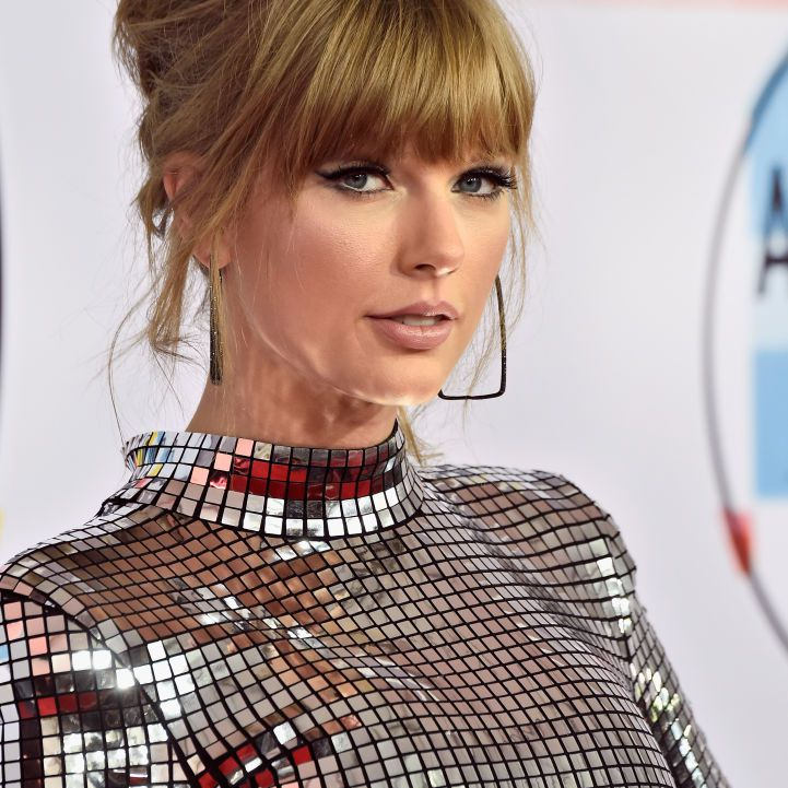 Taylor Swift updo with heavy bang