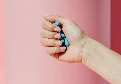 hand holding pills