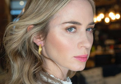 Emily Blunt in white top with pink lipstick