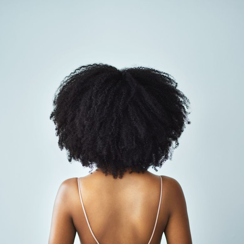 woman with kinky, curly natural hair and a smooth back