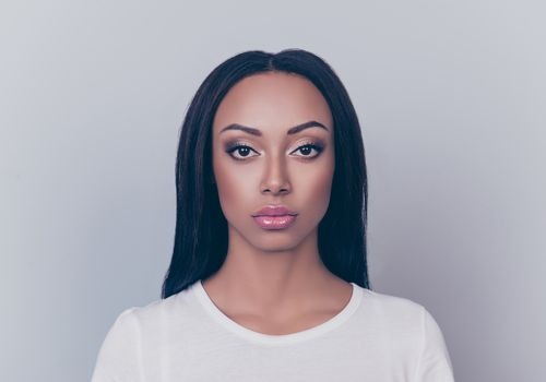 Black woman with relaxed, straight hair