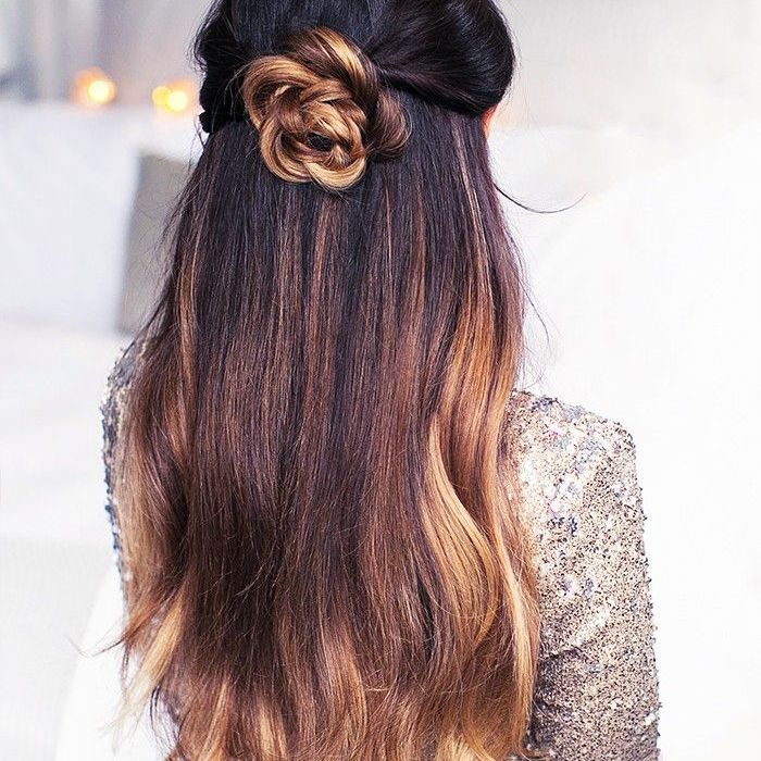 Woman with brown balayage hair styled in a twisted-flower bun