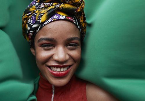 Beautiful Black woman against green background