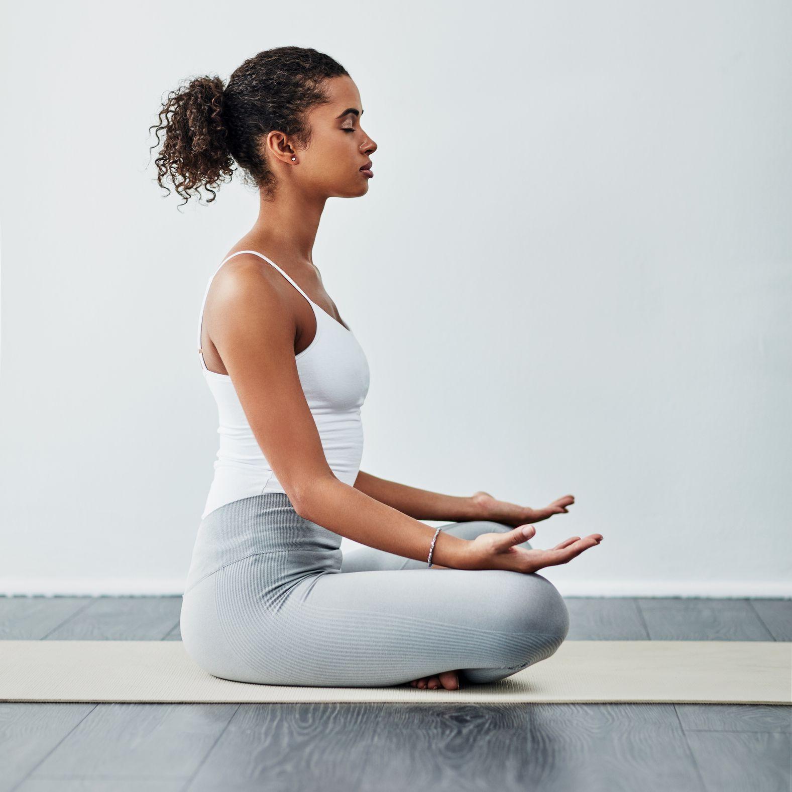 woman meditating side view