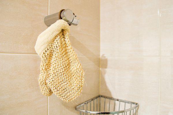 exfoliating glove in shower