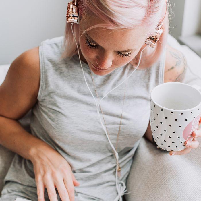 white noise: woman listening to headphones