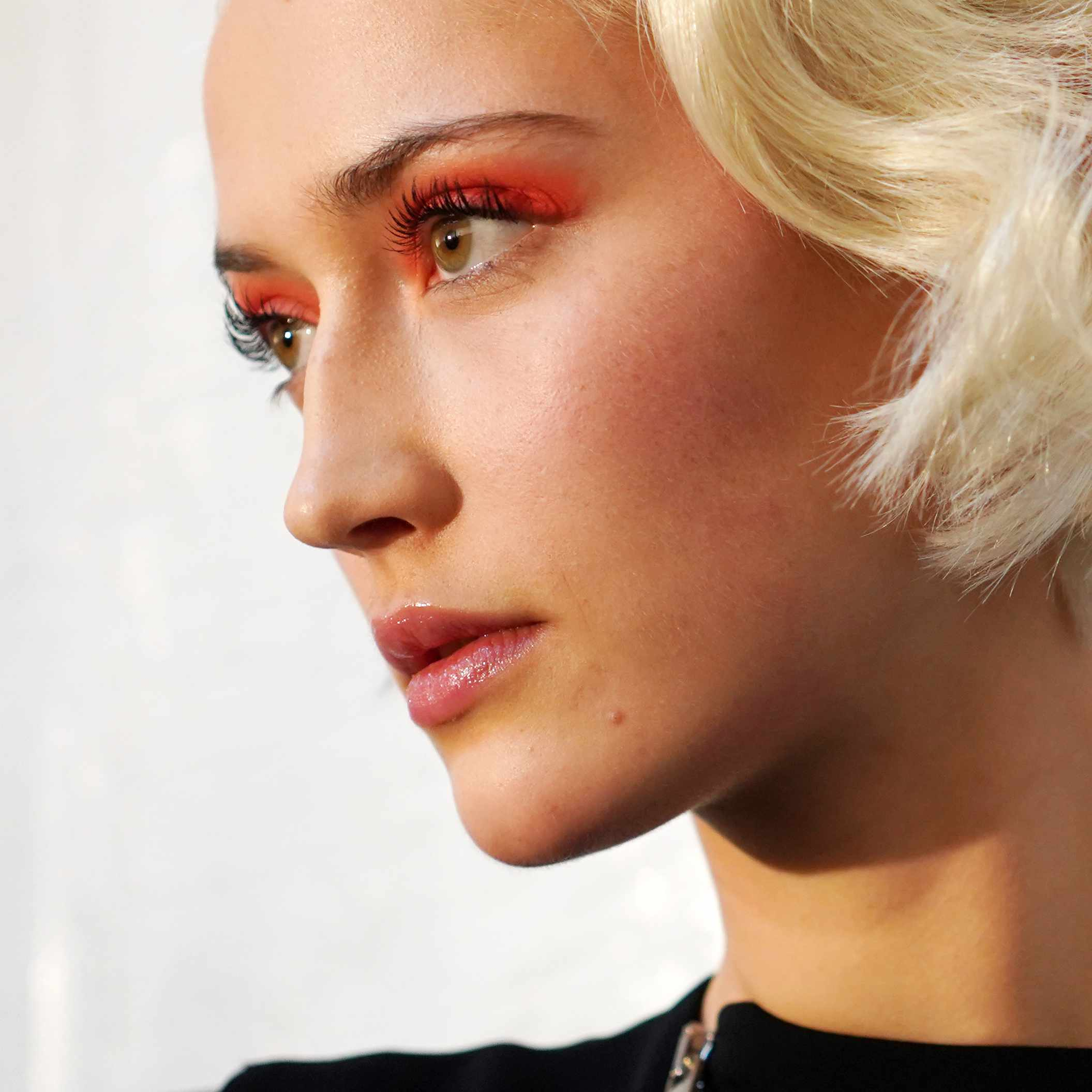 blonde woman with orange eyeshadow