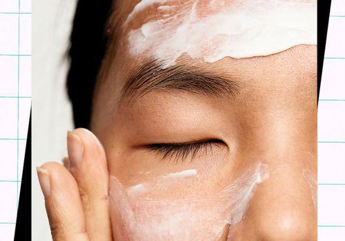 woman applying cream to eczema