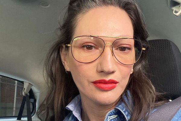 selfie of woman in car with red lipstick