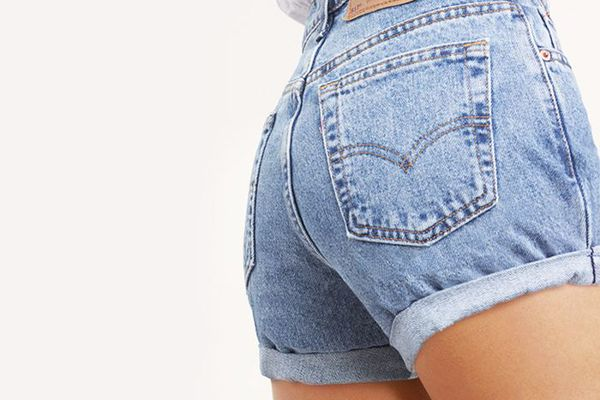 Woman wearing high-waisted denim shorts