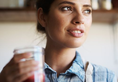woman drinking a fresh juice