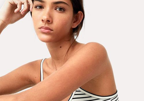 model with striped tank top