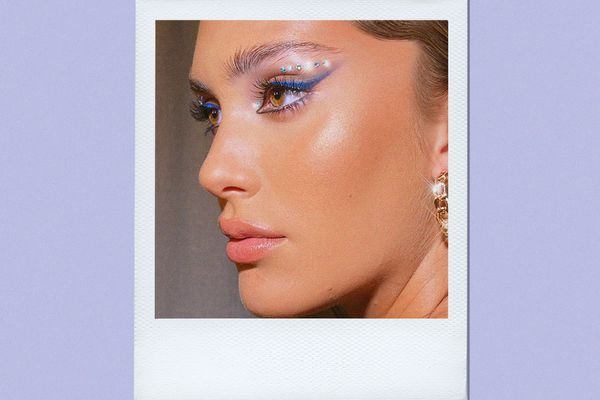 woman wearing bedazzled eye makeup