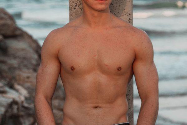 shirtless man on beach
