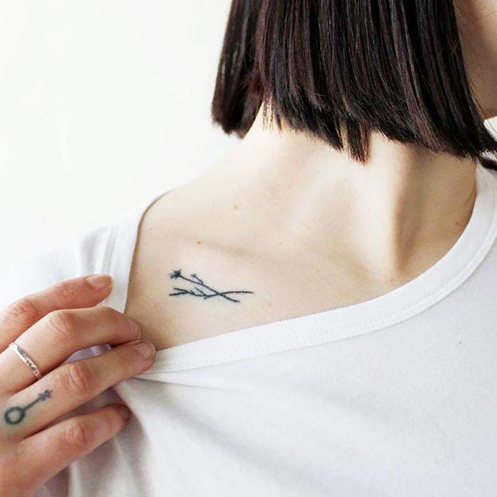 Minimalist tattoo below collar bone