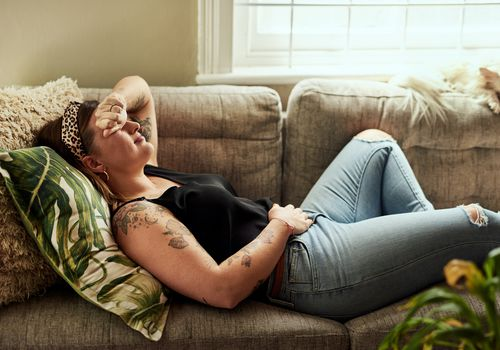 Woman suffering from stomach cramps