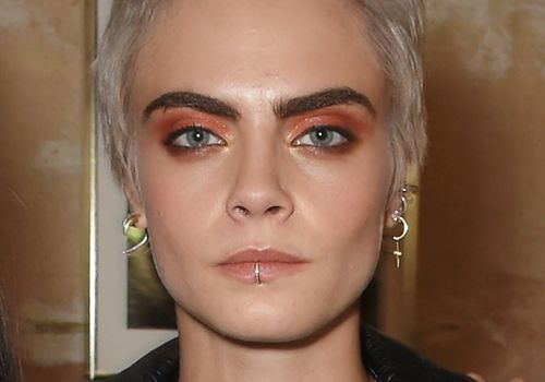Cara Delevingne lip ring piercing