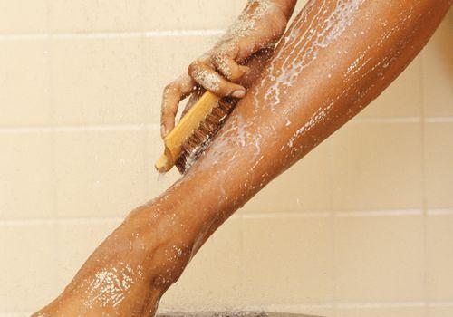 Woman exfoliate leg