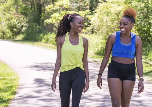 Two women fitness walking exercise
