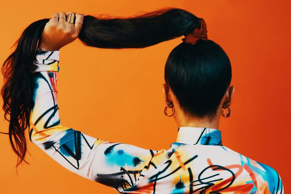 person holding hair in a ponytail