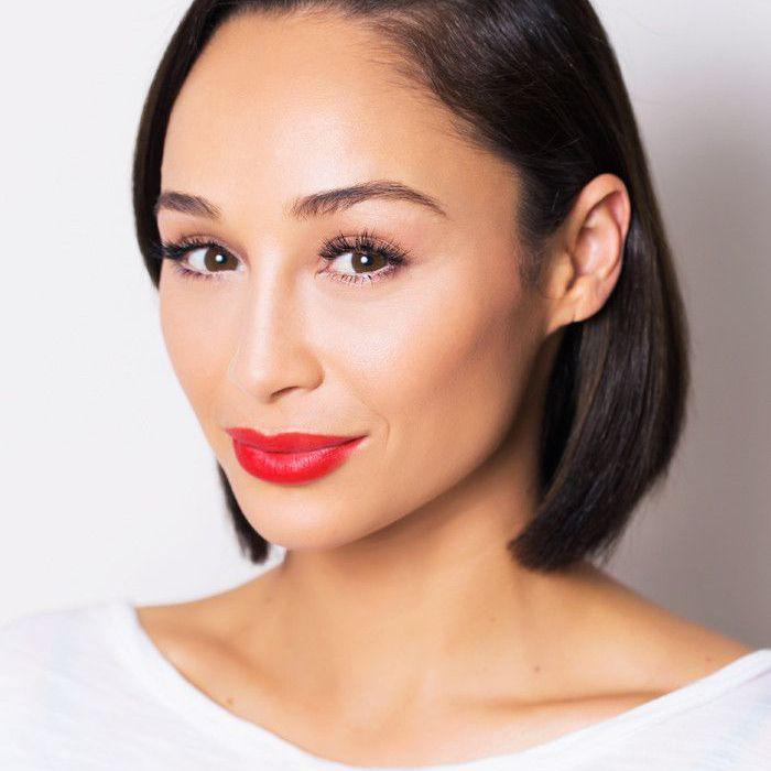 Actress Cara Santana wearing a bold red lip