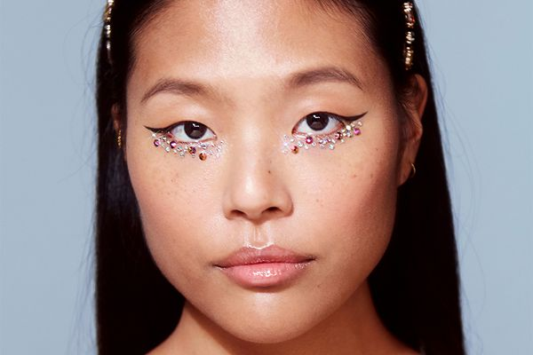 asian femme with gemstones and winged liner