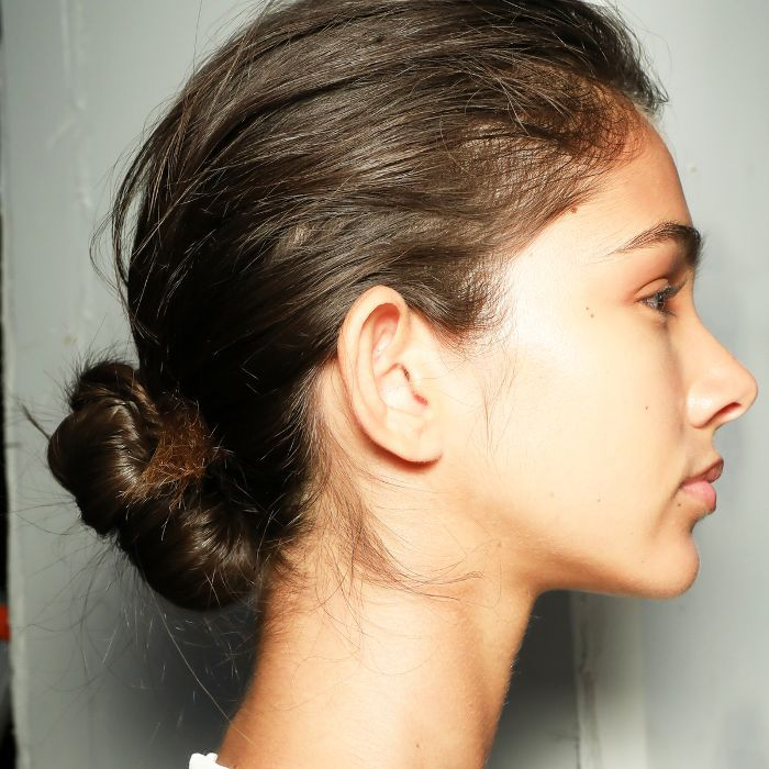 Model with her hair pulled back in a low bun