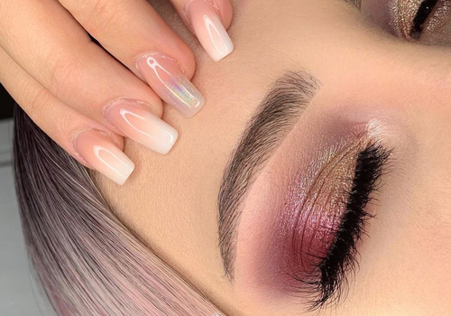 woman with mapped eyebrows and rose gold eyeshadow