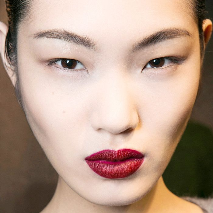 brunette woman with black eyeliner and dark red lipstick