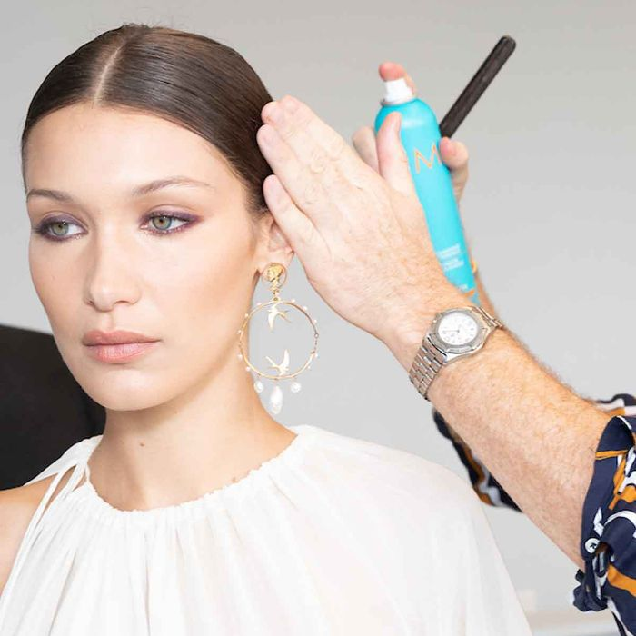 Bella Hadid having her hair styled in a low ponytail