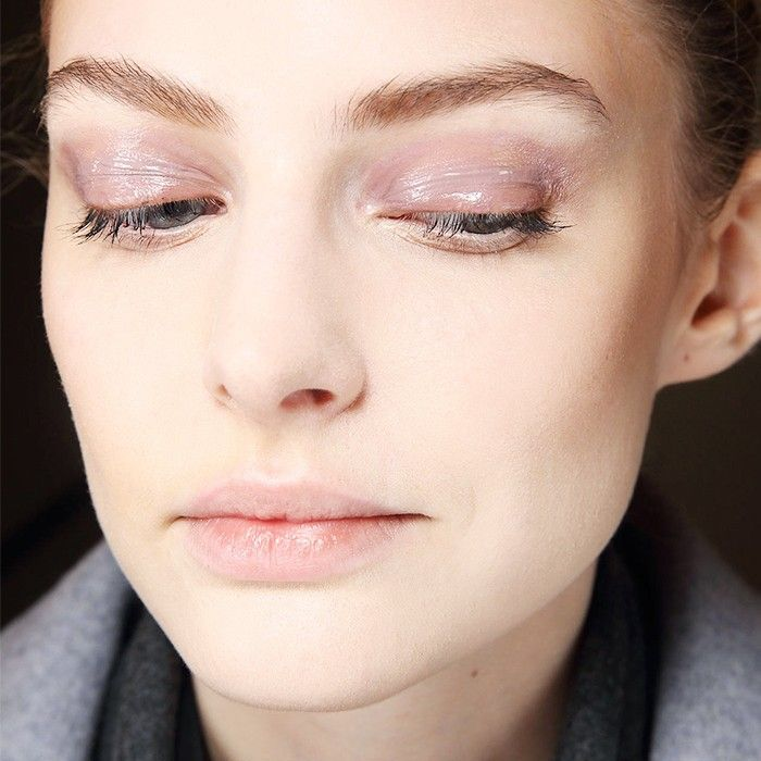 Woman with glossy eyelids