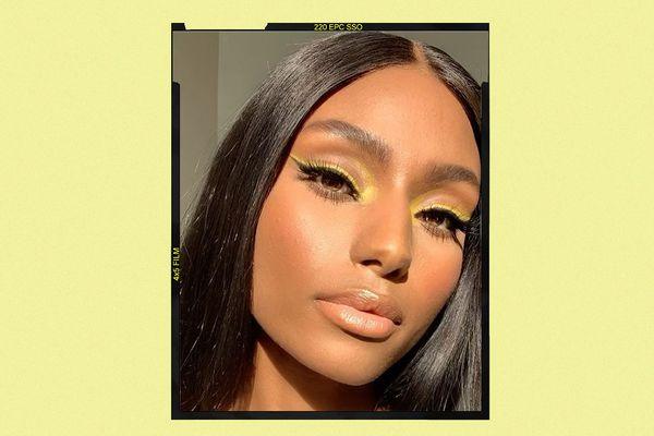 woman wearing neon yellow eyeliner