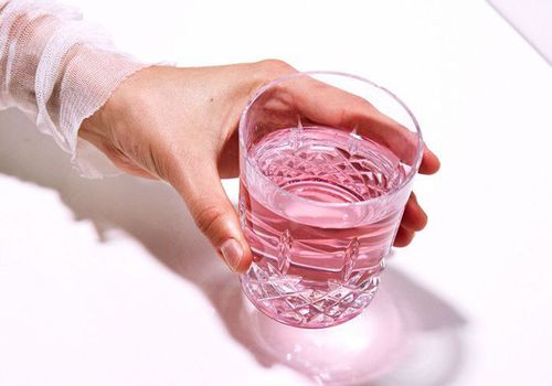 woman holding pink water