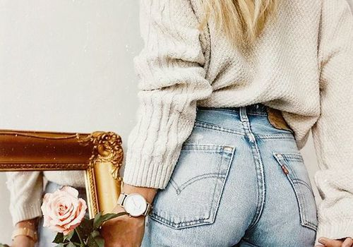 photo of girl's butt with rose in hand and mirror