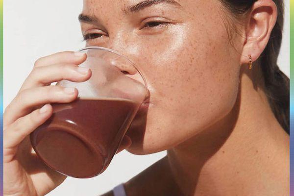woman drinking protein powder drink
