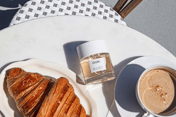 Croissant and coffe with perfume