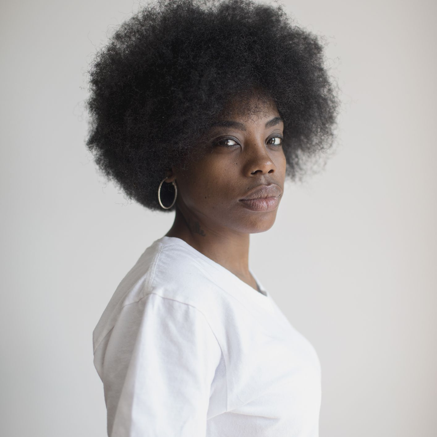 Young Black woman with medium length afro