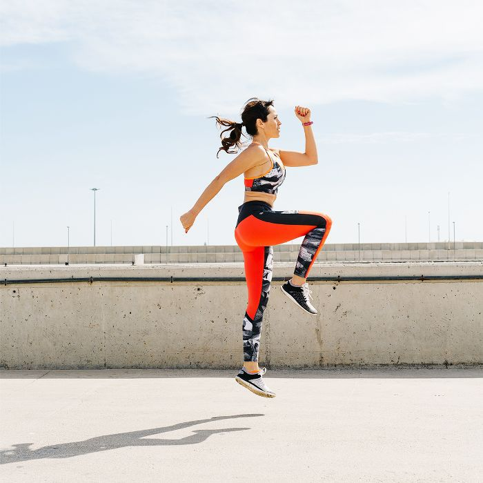how to get an energy boost: woman leaping in the air